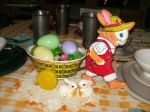 Tin lithograph rabbit and cart with Easter grass and candy